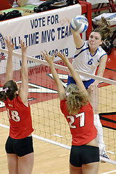 24 November 2006: Jessie Janik (18) and Katie Seyller (27) attempt a block on a ball struck by Carolyn Decker during a Quarterfinal match between the Illinois State University Redbirds and the Creighton University Bluejays. The Tournament was held at Redbird Arena on the campus of Illinois State University in Normal Illinois.<br />