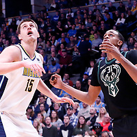 01 April 2018: Denver Nuggets center Nikola Jokic (15) vies for the rebound with Milwaukee Bucks center John Henson (31) during the Denver Nuggets 128-125 victory over the Milwaukee Bucks, at the Pepsi Center, Denver, Colorado, USA.