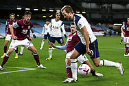 Burnley defender Matthew Lowton (2) gets the tackle on Tottenham Hotspur forward Harry Kane (10) during the Premier League match between Burnley and Tottenham Hotspur at Turf Moor, Burnley, England on 26 October 2020.