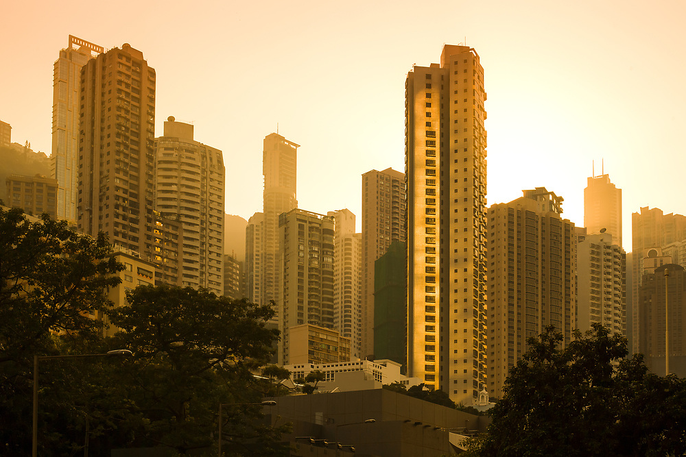 Sunset behind skyline of apartment buildings in the residential neighborhood of Chung Wan at Central Hong Kong, China.