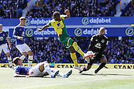 Everton Goalkeeper Tim Howard (r) saves from Cameron Jerome of Norwich City. Barclays Premier League match, Everton v Norwich City at Goodison Park in Liverpool on Sunday 15th May 2016.<br /> pic by Chris Stading, Andrew Orchard sports photography.