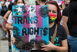 A protester holds a sign reading Trans Rights as thousands of people take part in a London Trans+ Pride march from the Wellington Arch to Soho Square on 26th June 2021 in London, United Kingdom. London Trans+ Pride is a grassroots protest event which is not affiliated with Pride in London and focuses on creating a space for the London trans, non-binary, intersex and GNC community to come together to celebrate their identities and to fight for their rights.