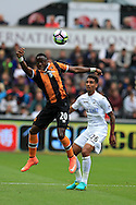 Adama Diomande of Hull city (l) holds off Kyle Naughton of Swansea city. Premier league match, Swansea city v Hull city at the Liberty Stadium in Swansea, South Wales on Saturday 20th August 2016.<br /> pic by Andrew Orchard, Andrew Orchard sports photography.