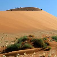 Africa, Namibia, Sossusvlei. Hikers on distant dune appear as ants in Sossusvlei.