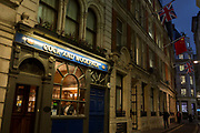 After work evening drinkers stand in the window of the Cock and Woolpack pub in Finchstreet in the Square Mile, the heart of the capitals ancient financial district, on 2nd October 2017, in the City of London, England.
