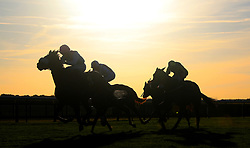 Runners and riders make their way down the home straight during The British Stallion Studs EBF 'Jersey Lily' Fillies Nursery Handicap Stakes during day three of the Cambridgeshire Meeting at Newmarket Racecourse.