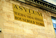 Old sign for asylum for teaching young females household work, Bath, Somerset, England, UK