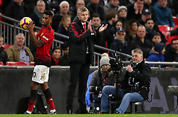 Manchester United interim manager Ole Gunnar Solskjaer (right) applauds on the touchline
