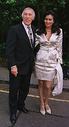 MR & MRS BRUCE FORSYTHE, he is the TV presenter she was a former Miss World, at a party in London on 30th June 1999.MTY 3
