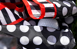 May 4, 2019 - Charlotte, NC, USA - Joel Dahmen's ball rests in the fold of Carol Parsons' umbrella off the 5th green at Quail Hollow Club in Charlotte, N.C., during third-round action of the Wells Fargo Championship on Saturday, May 4, 2019. (Credit Image: © TNS via ZUMA Wire)