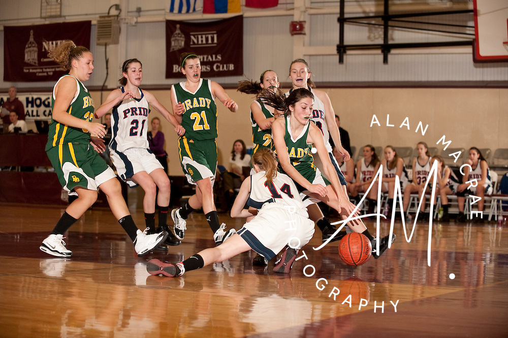 Bishop Brady's Kaley Marston reaches for the ball after colliding with MV's Hannah Young in Monday's action at NHTI in Concord.  (Alan MacRae/for the Monitor)