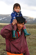 Stunning images reindeer herders of Mongolia<br /> <br /> Tsaatan people are reindeer herders and live in northern Khövsgöl Aimag of Mongolia. Originally from across the border in what is now Tuva Republic of Russia,the Tsaatan are one of the last groups of nomadic reindeer herders in the world. They survived for thousands of years inhabiting the remotest Ulaan taïga, moving between 5 and 10 times a year. <br /> The reindeer and the Tsaatan people are dependent on one another. Some Tsaatan say that if the reindeer disappear, so too will their culture. The Tsaatan depend on the reindeer for almost, if not all, of their basic needs:  their reindeers provide them with milk, cheese, meat, and transportation. They sew their clothes with reindeer hair, reindeer dung fuels their stoves and antlers are used to make tools. They do not use their animals for meat. This makes their group unique among reindeer-herding communities. As the reindeer populations shrink, only about 40 families continue the tradition today. Their existence is threatened by the dwindling number of their domesticated reindeer. Many have swapped their nomadic life for urban areas. <br /> <br /> Sosor and his daughter, living at the same camp<br /> ©Pascal MANNAERTS/Exclusivepix Media