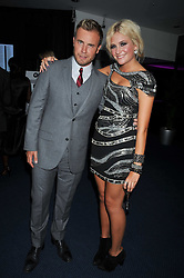 GARY BARLOW and PIXIE LOTT at the annual GQ Awards held at the Royal Opera House, Covent Garden, London on 8th September 2009.