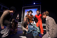 """Emma Morel-Jason, Sophie Pankhurst-Colleen, Grace Southworth-Steve, Riley Chick-Andy, Seda Boles-Alex, Miles Sargent-Mike and Shyann Perez-Mr. Matheson surround Santiago McCulloch0-Eric during dress rehearsal for """"Boy Who Drew Cats"""" at the Winnipesaukee Playhouse on Wednesday evening.  (Karen Bobotas/for the Laconia Daily Sun)"""