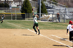 05 April 2008: Valerie Hackett can't stretch high enough to pull in this thorw to first from the 3rd baseman. The Carthage College Lady Reds lost the first game of this double header to the Titans of Illinois Wesleyan 4-1 at Illinois Wesleyan in Bloomington, IL