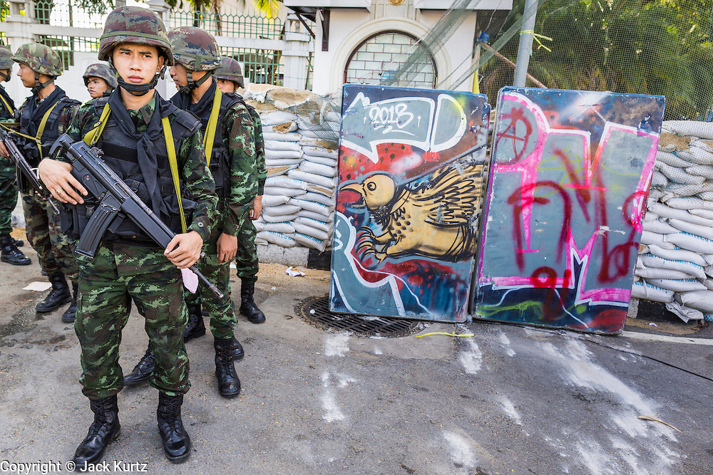 23 MAY 2014 - BANGKOK, THAILAND: Thai soldiers at a checkpoint in the Dusit district in Bangkok Friday. The Thai military seized power in a coup Thursday evening. They suspended the constitution and ended civilian rule. This is the 2nd coup in Thailand since 2006 and at least the 12th since 1932. The army has ordered both anti-government protestors in Bangkok and pro-government protestors in the suburbs to go home and arrested leaders of both groups.    PHOTO BY JACK KURTZ