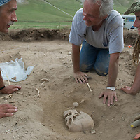 Smithsonian archaeologist & forensics specialist, Dr. Bruno Frohlich (center) unearths a bronze-age skeleton at a site above the Delger River near Muren, Mongolia.  His colleague, Dr. William Fitzhugh (L), was studying nearby deer stones from the same period.