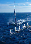 Club Med winner of The Race, a round the world, no limits race practicing off the coast of Monaco.  These are the world's fastest sailboats attaining speeds of more than 40 knots.