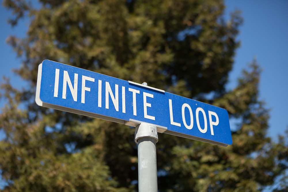 View of the street sign outside Apple's One Infinite Loop headquarters in Cupertino, California. <br /> Copyright 2015 John O'Boyle<br /> john@johnoboyle.com