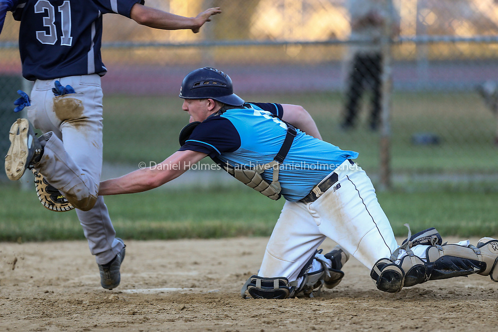 Franklin's Jon Turner tags but the runner is acted safe at home during the Senior Babe Ruth game against Framingham at Bowditch Field, on Jul. 21, 2020. [Daily News and Wicked Local Photo/Dan Holmes]