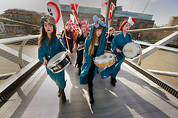 © Licensed to London News Pictures 08/03/2012 London, UK. .All girl band Gaggle, march across Millennium Bridge, London to mark International Women's Day. Flagship events took place across the globe as part of the worlds largest women's rights campaign..Photo credit : Simon Jacobs/LNP