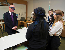 Pictured: John Swinney chatted with some of the chemistry students<br /> <br /> Deputy First Minister and Education Secretary John Swinney visited St Augiustine's RC High School in Edinburgh to speak to young people about attainment and leaving schools with the suite of statistics published today. St Augustine's RC High School<br /> <br /> <br /> Ger Harley | EEm 19 June 2018