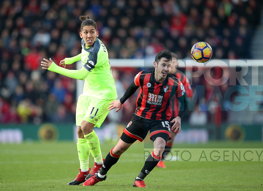 Bournemouth's Adam Smith tussles with Liverpool's Roberto Firming during the Premier League match at the Vitality Stadium, London. Picture date December 4th, 2016 Pic David Klein/Sportimage