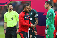Football - 2019 / 2020 Premier League - Southampton vs. Newcastle United<br /> <br /> Southampton's Ryan Bertrand offers his hand for the handshakes before kick off at St Mary's Stadium Southampton<br /> <br /> COLORSPORT/SHAUN BOGGUST