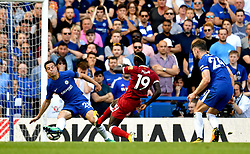 Liverpool's Sadio Mane (centre) has a shot on goal but misses during the Premier League match at Stamford Bridge, London.