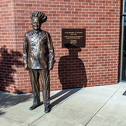 """Milton, PA - July 26, 2016: The Chef Boyardee statue at the ConAgra Foods factory is the By-Ar-Dee company founder Italian immigrant Ettore """"Hector"""" Boiardi."""