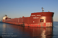Ore freighter approaches Duluth Ship Canal on a summer evening at Duluth, Minnesota.
