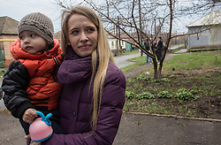 Olga Malishenko, 23, with her son Vladislav, 2yrs 7 months, at the MSF mobile clinic held in Bolshaya Vergunka, Lugansk.