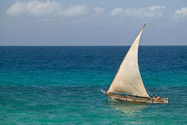Dhow fishing boat on blue waters, Chumbe Island Coral Park, Tanzania, Africa