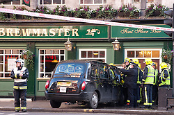 © under license to London News Pictures. 05/12/2010. A Taxi crashes into The Brewmaster Public house Leicester Square Tube Station. Picture credit should read: Julie Edwards/London News Pictures