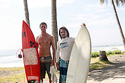 Two surfers with surfboards photographed at El Tunco beach, El Salvador