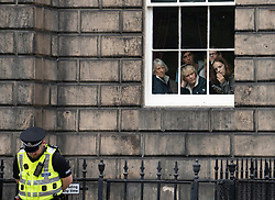 Edinburgh, Scotland, UK. 29 July 2019. Prime Minister Boris Johnson meets Scotland's First Minister Nicola Sturgeon at Bute House in Edinburgh on his visit to Scotland. Pictured. Curious office workers await the arrival of Boris Johnson at next door Bute House.