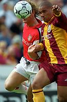 Andy Myers (Bradford) holds off Ray Parlour (Arsenal). Bradford City 1:1 Arsenal, F.A. Carling Premiership, 9/9/2000. Credit Colorsport / Stuart MacFarlane.