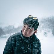 Karma Wangchuk wearing fashionable sunglasses. A walk around Laya village during a snow storm.