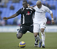 Photo: Aidan Ellis.<br /> Bolton Wanderers v Fulham. The Barclays Premiership. 11/02/2007.<br /> Fulham's Papa Bouba Diop (L) and Bolton's El Hadji Diouf battle for possesion