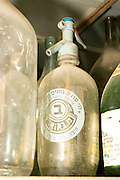 Old style glass soda water bottle with metal Syphon