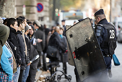 PARIS, Oct. 31, 2016 (Xinhua) -- A policeman restrains migrants during a police operation aiming at a future evacuation of a refugee camp in Paris, France, on Oct. 31, 2016. French Police on Monday checked identities of thousands of migrants camping outside Stalingrad Metro Station, north Paris to prepare the camp's evacuation, local media reported. (Xinhua/John Fiddler) (dtf) (Credit Image: © John Fiddler/Xinhua via ZUMA Wire)