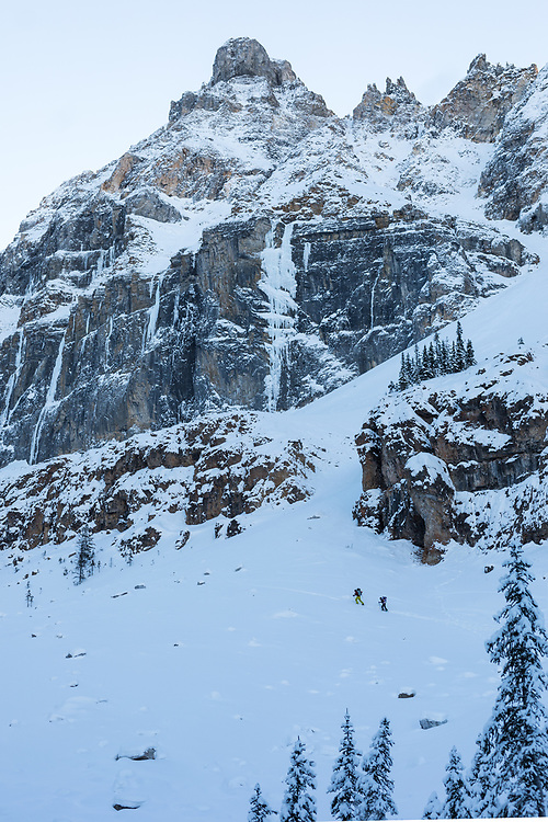 Brette Harrington approaching the ice climbing Silmarillion WI6 165m in Storm Creek, Kootenay National Park, BC, Canada
