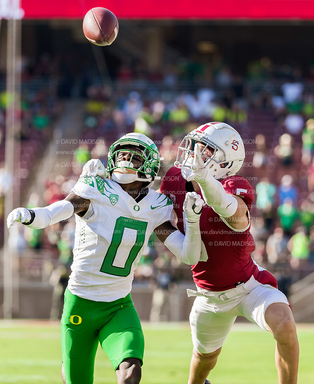 PALO ALTO, CA - OCTOBER 2:  DJ James #0 of the Oregon Ducks and John Humphreys #5 of the Stanford Cardinal view for the ball during a pass play in an NCAA Pac-12 college football game on October 2, 2021 at Stanford Stadium in Palo Alto, California.  (Photo by David Madison/Getty Images)