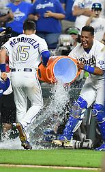 May 18, 2018 - Kansas City, Missouri, U.S. - KANSAS Kansas City, MO - MAY 18:  Kansas City Royals catcher Salvador Perez (13) misses hitting Kansas City Royals designated hitter Whit Merrifield (15) with an after game dunk of water after winning a Major League Baseball game between the New York Yankees and the Kansas City Royals on May 18, 2018, at Kauffman Stadium, Kansas City, MO. Kansas City won, 5-2.  (Photo by Keith Gillett/Icon Sportswire) (Credit Image: © Keith Gillett/Icon SMI via ZUMA Press)