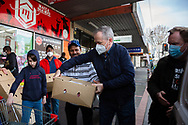 Bill Shorten (centre) and the Secretary of Victorian Trades Hall, Luke Hilakari (R) help locals load much needed halal meat into a truck bound for the residents of the locked down housing commission towers during COVID-19 on 10 July, 2020 in Melbourne, Australia. Former Federal Labor Leader Bill Shorten, along with close allies at Trades Hall help deliver Halal meat, supplied by Macca Halal Foods to the locked down housing commission towers following a coronavirus outbreak detected inside the complex. Mr Shorten was able to use his high profile to ensure food was not turned away by police so that it would reach the residents inside. (Photo be Dave Hewison/ Speed Media)