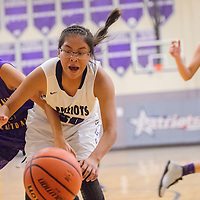 Miyamura Patriot Odessa Begay (20) and Kirtland Central Bronco Haile Gleason (10) compete for control of the ball Friday at Miyamura High School.