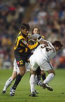 13/3/2004 Madrid, Spain.<br />La Liga, day 28.<br />R.Madrid 1 - Zaragoza 1<br />R.Madrid's Juanfran in duel against Zaragoza's Toledo at Santiago Bernabeu's Stadium.<br />© 2004 Alejandro leon Fernandez
