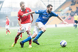 Ross County's EMartin Woods and St Johnstone's James McFadden. <br /> St Johnstone 2 v 1 Ross County, Scottish Premiership 22/11/2014 at St Johnstone's home ground, McDiarmid Park.