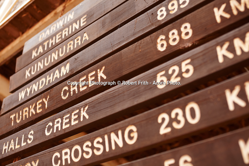 Distance signs at Willare Bridge Roadhouse between Broome and Derby