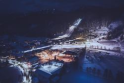 THEMENBILD - das beleuchtete Nordische Zentrum mit der Skisprungschanze und dem Langlaufstadion bei Dämmerung in der winterlichen Landschaft, aufgenommen am 17. Dezember 2018 in Ramsau, Oesterreich // the illuminated nordic center with the ski jumping hill and the cross country stadium at dusk in the wintry landscape, Ramsau, Austria on 2018/12/17. EXPA Pictures © 2018, PhotoCredit: EXPA/ JFK